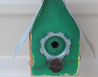 birdhouse Christmas ornament- recycled wood painted red and green with rustic metal roof and found objects for decoration