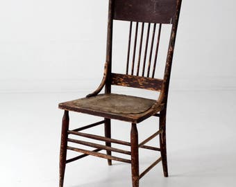 antique chair with pressed leather seat, wood spindle back chair
