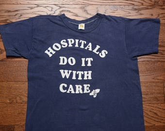 vintage 60s 70s t-shirt Hospitals Do It With Care doctor nurse tee shirt 1960 1970 novelty funny slogan shirt S/M 100% cotton Russell