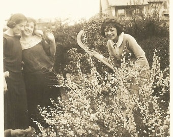 "Vintage Photo ""The Nutty Gardener"" Scythe Forsythia Flower Garden Laughing Girls Found Vernacular Photo"