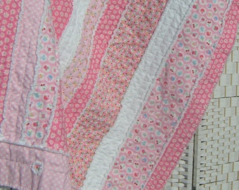 Pink cot quilt, throw, rag quilt, baby girl, blanket, lap quilt. All cotton. Snuggly soft. Flowers, cupcakes, daisies, dots.