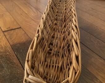 French baguette basket. Wicker bread basket used in French bakery