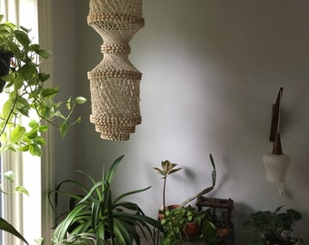 boho chic shell chandelier. hanging mid century shell planter. boho shell light fixture. bohemian sea shell plant hanger. vintage shell lamp