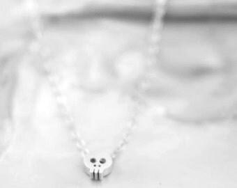 Tiny skull necklace - Matt