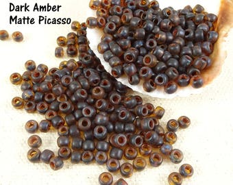 TOHO Seed Beads - 6/0 Hybrid Frosted Transparent Topaz, Amber (T6/SM-Y313F) - 4mm Seed Beads - Qty 10 grams