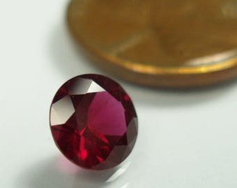 AAA Chrome Pyrope Garnet,  Anthill Garnet, faceted chrome pyrope,  6.5 mm round brilliant cut, 1.14 carats, brilliant bright red gemstone