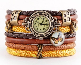bracelet and a watch, cuff, stylish watch,orange, brown, yellow, butterfly