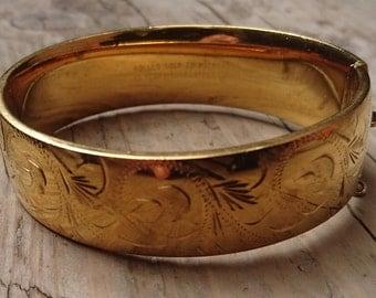 Vintage engraved rolled gold bangle