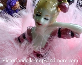 Powder Puff Porcelain Doll with candy pink boa