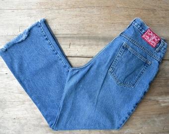 Size 32 Vintage Flare Leg Jeans by No Excuses / Raw Edge Hem / Frayed Hem / 90's Denim / 32 inch Waist