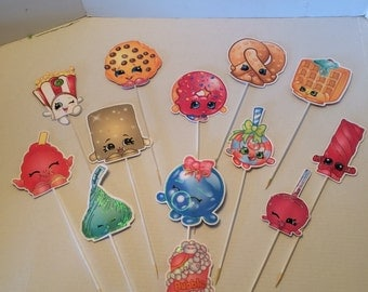 Shopkins - four five inch shopkins images on wooden skewers painted white.  Double sided 10.00