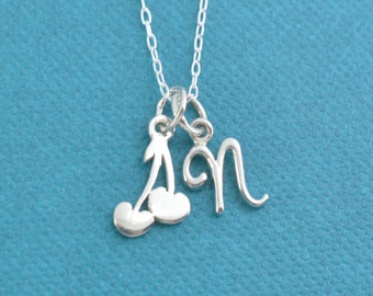 """Little girl's cherry necklace in sterling silver on a 14"""" sterling silver cable chain and personalized with a sterling silver initial."""