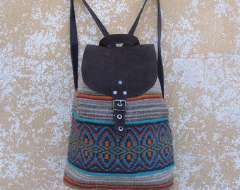 Ladies boho backpack - handmade of suede leather and unique colorful handwovne wool fabric in grey. red, blue and orange