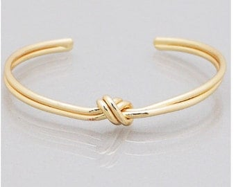 Metal love knot twist cuff bracelet