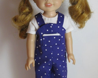 Wellie Wisher Purple Polka Dot Overalls, White Top, Purple Hat and Black Shoes