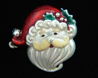 Vintage Santa Christmas pin. Sweet-faced Santa. Sprig of holly stuck in his hatband. On the end of his hat, a tinkling sleigh bell. SC-36