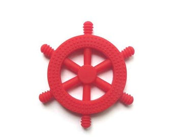 Teething toy, silicone toy, chew toy for babies, pacifier clip attachement, red wheel
