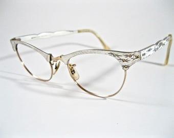 Vintage cat eye glasses w/ AB rhinestones. Starburst design. Silver aluminum filigree ornate frames. No lenses. Art-Craft 48-20.