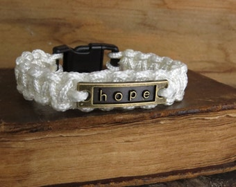 Hope Survival Bracelets, Knotted Skinny Paracord, Brass Hope Charm, Black Plastic Buckle, White or Black, #Resist, Indivisible