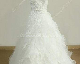 Romantic strapless tulle lace wedding dress with asymmetrical ruffles