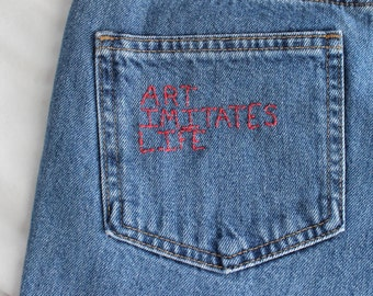 "embroidered jeans, ""art imitates life, life imitates art"", upcycled hand embroidered women's jeans art quote"