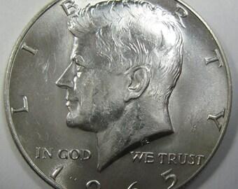 1965 silver Kennedy half dollar collector coin grades unc (#E214c)