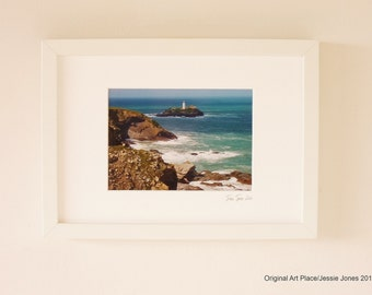 Small framed photograph, 'Lighthouse in Cornwall' by Jessie Jones