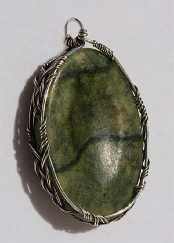 Kilkenny marble pendant wrapped Celtic style in silver