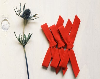 Handtied [ red ] bow
