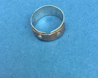 Handmade rivet ring, Sterling silver riveted ring. With copper bar, Size P 1/2 UK, size 7 3/4 US. riveted copper and silver ring