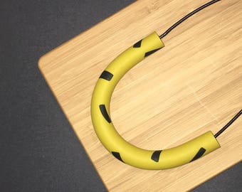 Polymer clay necklace. Polymer clay curved bar pendant. mustard and black 'The amy'