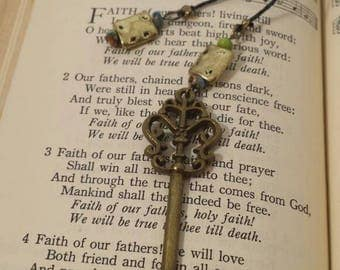 Bronze key bookmark with multicolored and gold beads