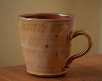 Pottery Coffee Mug, Hot Cocoa Mug, Coffee Cup by Fire Garden Pottery. 10 oz pottery mug. Shino with matte cream-orange glaze.