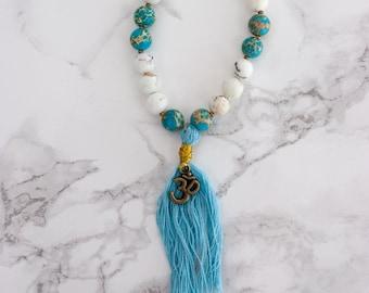 Handmade, one-of-a-kind Bracelet with Lapis Lazuli, White Howlite & Om Charm