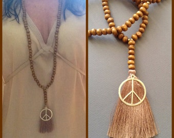 """Mala symbol peace, wooden beads,, Silk thread pompom / Brown / Hippie chic-Boho chic / gypsysoul / pendant """"peace and love"""""""