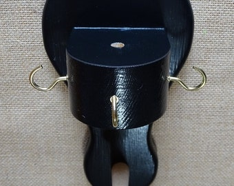 Hat peg with tiller pin holder