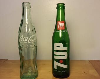 Vintage Coke bottle and 7UP bottle