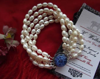 Item N-0079 - Five Strand Pearl Cuff with Blue Glass Reverse Intaglio Flower Clasp