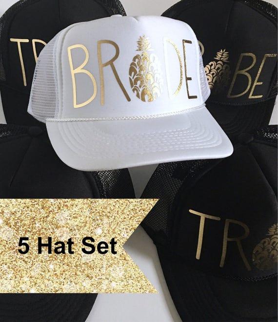 5 Bride Tribe Hat SET| Bride Hat| Bachelorette Hat| Bridesmaid Hat| Pineapple| 1 White Bride, 4 Black Tribe Hats-Gold Vinyl lettering
