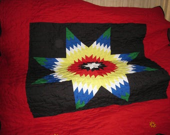 star quilt with sun