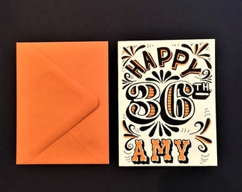orange black and white hand lettered customized happy birthday card