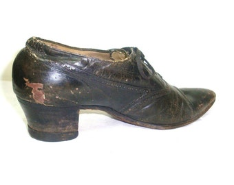 Antique women's lace up leather shoe. Dark brown pump heel. Nailed heel, stitched sole. For decor only unless you have the other one.