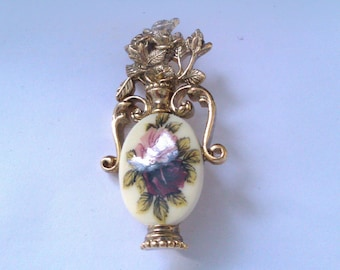 gold coloured ceramic vase flower brooch