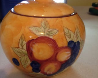 Brightly colored covered glazed candy dish