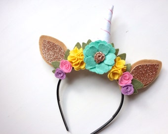 Unicorn Princess Felt Horse Ear headband - icy blue with rose gold center and yellow, pink and lavender flowers with green leaves