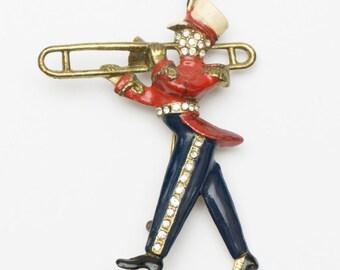 Vintage Cast Marching Trombone Player Enamel and Rhinestone Brooch
