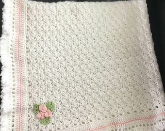 Homemade crochet baby blanket with pink roses