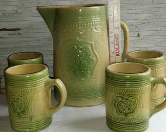 Vintage Stoneware Cider Pitcher and 4 matching mugs. Very nice condition for the age. All have crazing. Pitcher has a spider and a lip chip.