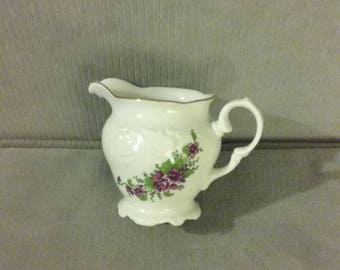 """From Poland: Flawless & Sparkling Walbrzych 5"""" x 3 3/4"""" Embossed Creamer With Gold Trim, Scalloped Base, And Floral Decoration"""