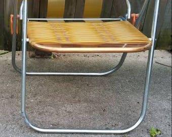 vintage orange vinyl tube folding lawn chair